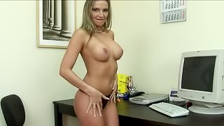 Cougar with nice ass drilling her pussy with toy in the office