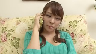 Horny clothed Japanese MILF with big tits gets to suck two cocks