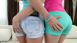 Two divine babes are sharing a huge double ended dildo