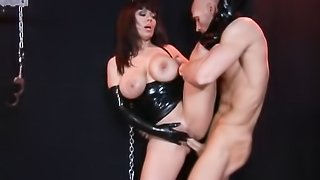 Insatiable brunette, wearing leather, black top and gloves loves sucking and riding this huge cock.