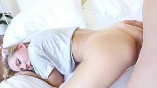 A blonde with a sexy small ass is fucking on the white bed sheets