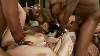 Bella Rossi gets her holes ripped apart by a few black studs