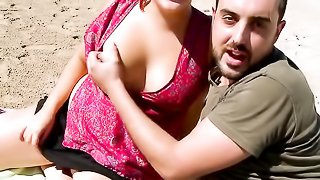 Chubby slut with nice tits plays with a big dick on the beach