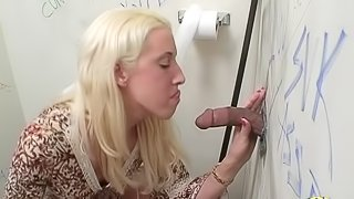 Slutty blonde babe gets to sucking and riding a black cock through a wall