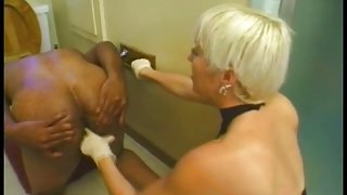 Blond mistress using a black guy as fuck toy in bathroom