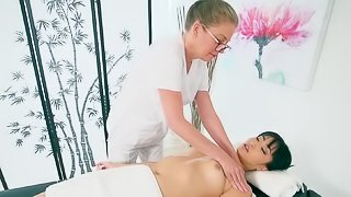 Asian woman is getting touched a lot on the massage table
