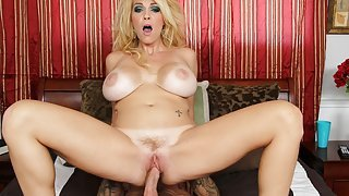 Charlee Chase exposes her tattooed...