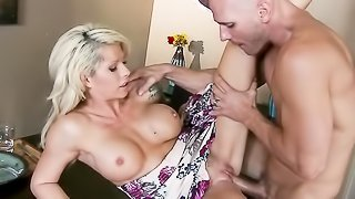Tattooed blonde in white, flowery dress blows guy under the table before getting her shaved cunt licked and rammed.