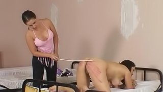 Getting her ass hit with a long stick makes this girl moan loudly