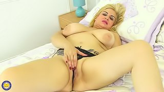 Spanish big breasted temptress fingering herself