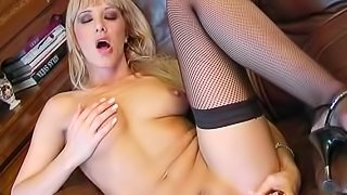 Solo doll Natalli di Angelo is fucking her wet vagina with huge silver dildo