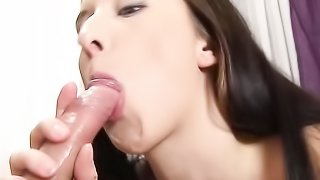 Skinny brunette sucks a dick and gets spunk on her perky titties