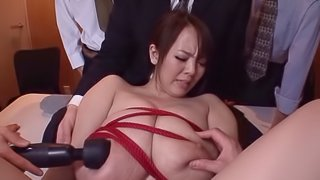 Vivacious Japanese broad with big tits enjoys a hot bdsm groupsex shoot in the office