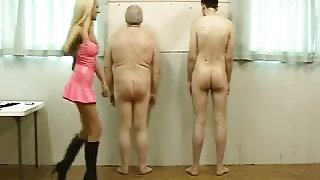 Sexy Mistress in Pink Latex Works Over Her 2 Slaves