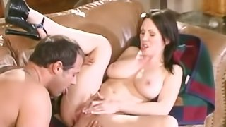 Breathtaking brunette with big tits licking heavy balls in close up shoot