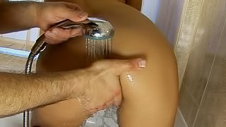 Slippery anal sex in the bathtub with a pigtailed cutie