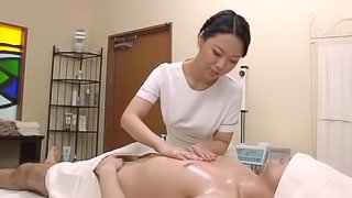 Hot Japanese masseuse gives great handjob to a guy