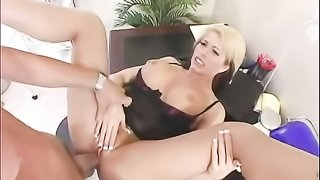Horny blonde doctor in dark red shirt and black skirt has her wet cunt eaten out and stuffed by football player.