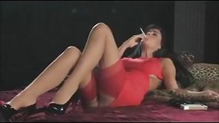 Smoking brunette in red suit + 120