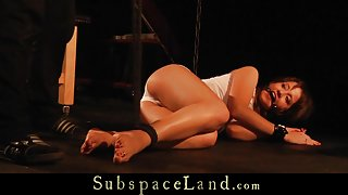 Girl tied and legs outspread is madly masturbated