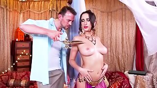 Oiled brunette is getting drilled deep