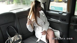 Busty British escort bangs in fake taxi