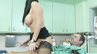 Sexy doc in black glasses and dark stockings screws a man back to life at the hospital.