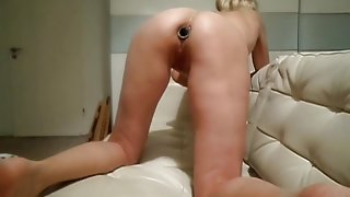 My little sex beast works on magic wand with plug in her ass