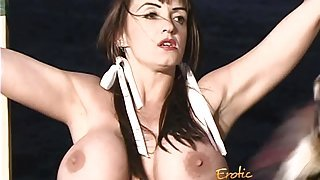 Hot bombshell with big tits gets bound and spanked by a werewolf