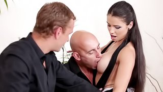A sexy chick gets double penetrated by two guys in suits