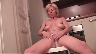 Fit granny with incredible tits teases her body