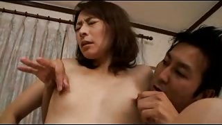 Passionate Japanese mature couple having hardcore sex