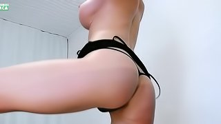 Hot Russian milf with huge tits showing her ass in front of the webcam
