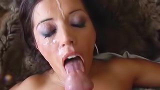 A MILF gives some sloppy head then gets cum splattered on her face