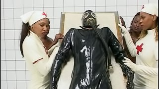 Black nurses in white latex fuck a white guy in a gas mask