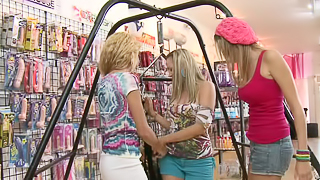 Blondes are having a lot of fun in a threesome in a sex shop