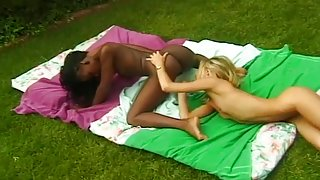 Two Hot Chicks Go At It On Grass Outside