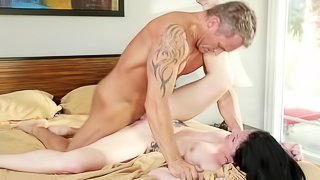 A dark haired chick that loves cock is getting licked on the bed
