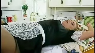 Banging a sexy blonde maid on a kitchen countertop