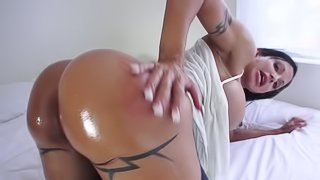 A milf that has huge tits is getting a dick up her wet oiled up ass