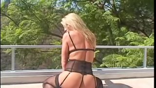Chelsea Zinn in stockings gets her anal banged by a big black cock in close up