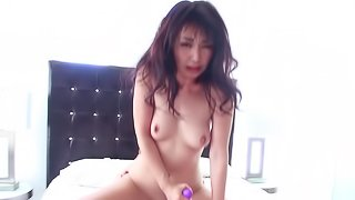 A chick uses a vibrator on her pussy and on a large dick too