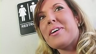 Sexy cougar getting down on a big cock at the gloryhole