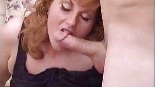 Busty Milf Mindy Jo sucking two cocks