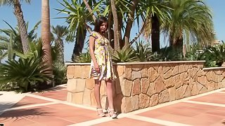 Lovely Henessy Masturbates Her Shaved Pussy Outdoors