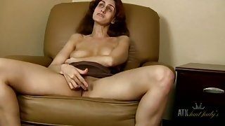 Freckled mature babe has a sexy bald pussy