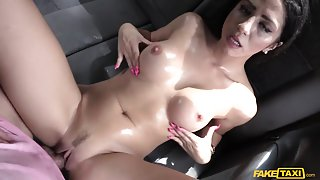 Julia in Spanish brunette beauty with nice shaved pussy - FakeTaxi