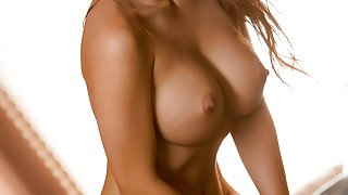 Stunning brunette undressing and caresses her hot-pussy