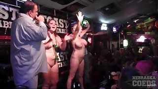 Naked babes in a bar sprayed with water