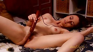 Cute milf gets out the vibrator to play in bed